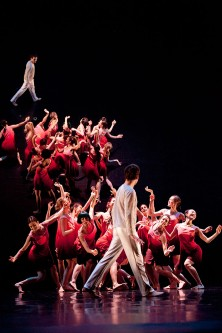 The Little Prince - female dancers wearing red and dancer Jérémy Galdeano during a group performance with reflexion