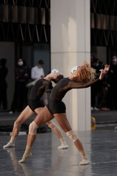 Tetyana Martyanova & Vanesa GR Montoya dancing on the outdoor stage of the Esplanade of Place des Arts