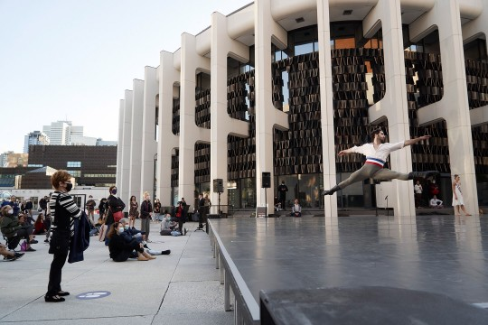 Corps de ballet, Esnel Ramos, dancing on the outdoor stage of the Esplanade of Place des Arts