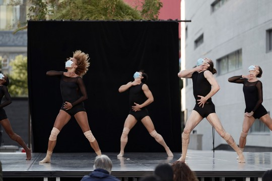 Les Grands Ballets' dancers performing on the outdoor scene of the esplanade of Place des Arts