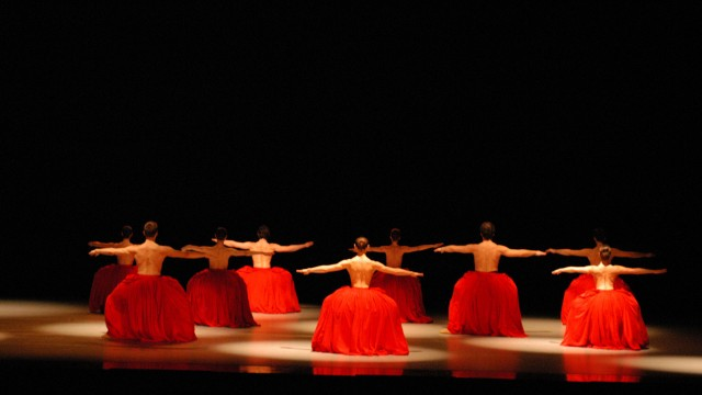 Bella Figura - dancers in red skirts doing a group performance
